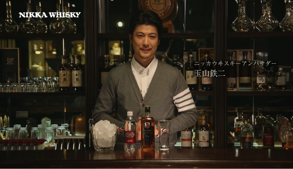 Screenshot of Nikka commercial with actor Tetsuji Tameyama mixing a Black highball.