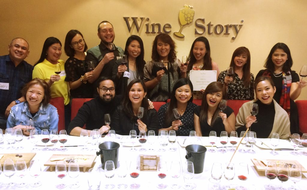 Carla in action: Happy students and a glass of wine in hand (far right)